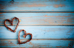 Two hearts on wooden background Royalty Free Stock Photos
