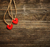 Two hearts on wooden background Royalty Free Stock Images