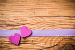 Two hearts on a wooden background Royalty Free Stock Photo