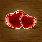 Two hearts on wooden background Stock Image