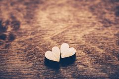 Two hearts on a wooden background Royalty Free Stock Image