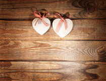 Two hearts and wooden background. Royalty Free Stock Photography