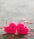 Two hearts on a wooden background Royalty Free Stock Photography