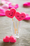 Two hearts on a wooden background Stock Photography