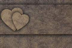Two hearts on wooden board Royalty Free Stock Images