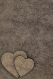 Two hearts on wooden board Stock Images