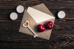 Two hearts, wooden key, and envelope, top view Stock Photography