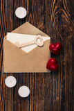 Two hearts, wooden key, and envelope, top view Royalty Free Stock Photo