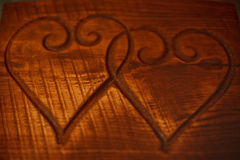 Two hearts on a wooden table Stock Photos