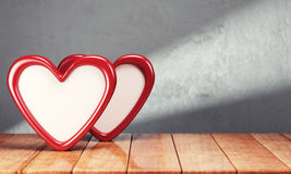 Two hearts on wooden table over gray background Stock Images