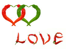 Two hearts and word Love composed of red and green chili peppers Stock Photo