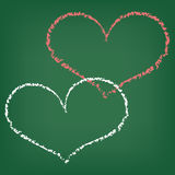 Two hearts written with chalk. Background with blackboard and two hearts written with chalk Stock Image