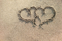Two hearts written on the sand. Royalty Free Stock Photography