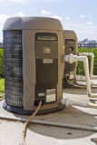 Two heat pumps with plumbing stock photography