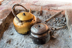 Two heating the tea over the fire. Preparing tea in Bedouin camp Royalty Free Stock Image