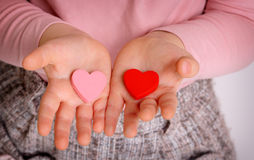 Two heats in little hands Royalty Free Stock Images