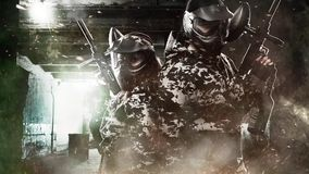 Two heavily armed masked paintball soldier on post apocalyptic background. Loop hd video for paint ball. stock video footage