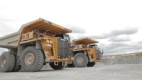 Two heavy dump trucks in the open pit. Two heavy dump trucks open coal pit stock footage