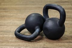 Two heavy kettlebell black royalty free stock images