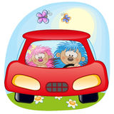 Two Hedgehogs in a car royalty free illustration