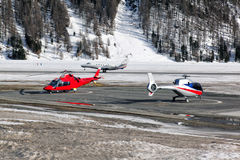 Two helicopters at the airport of St Moritz Royalty Free Stock Images