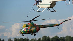Two helicopters flying close air show rescue operation. Helicopter takes off, goes down, extreme games in the helicopter near the forest, a helicopter airport stock video