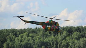 Two helicopters flying close air show rescue operation stock video