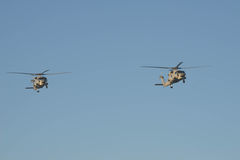 Two helicoptor in flight on ANZAC day dawn Stock Images