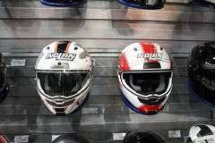 Two helmets in a shop. MOSCOW-MAY 31: Two helmets in a shop at the Moscow specialized exhibition  of motor cycling industry on May 31, 2012 in Moscow Stock Image