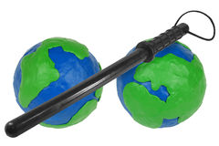 Two hemispheres and police baton Stock Image