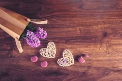 Two hemp hearts, macarons and hyacinth flowers in eco bag stock images