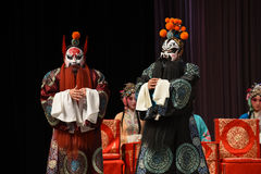 """Two heroes meet- Beijing Opera"""" Women Generals of Yang Family"""". This opera tells a patriotic story how does an old woman of a hundred years old go Stock Photography"""