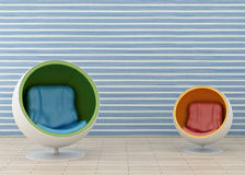 Two hi-tech armchair. And blue wallpaper Royalty Free Stock Photos