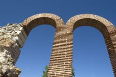 Two high brick semicircular arches. On blue sky background Stock Photography