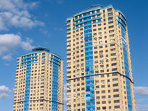 Two high modern apartment building on blue sky wit Royalty Free Stock Photos