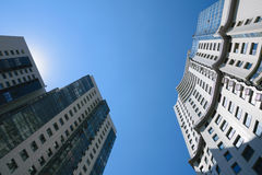 Two high-rise buildings in sunlight rays Royalty Free Stock Photography