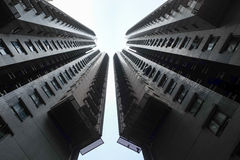 Two high rise buildings. Symmetrical mirror images of each other Royalty Free Stock Images