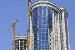 Two high-rise buildings under construction. Two high-rise building under construction close-up Stock Photos