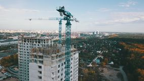 House construction crane stock footage