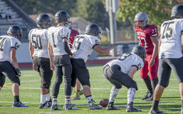 High School football teams facing off. Two high school football teams facing off on the field Royalty Free Stock Photos