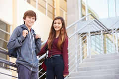 Two High School Students Standing Outside Building Royalty Free Stock Image