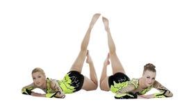 Two high skill gymnasts beauty portrait isolated. Two high skill acrobats women funny portrait isolated Stock Photo