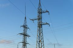Two high voltage electric line poles stock images