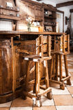 Two high wooden bar chairs in country style Royalty Free Stock Photos