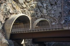 Two Highway Tunnel Entrances cut into a Mountainside.  stock image