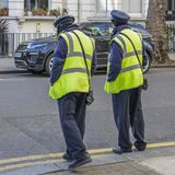 Two Highways Agency Traffic Officers, their purpose is to write tickets parking violations on Kensington and Chelsea royalty free stock images