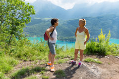 Two hiker women talking near of Lake Annecy royalty free stock photos
