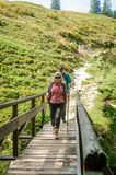 Two hiker on a wooden bridge Royalty Free Stock Image