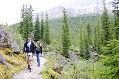 Two hikers. On a trail at Lake Moraine Stock Photos