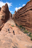 Two hikers. On a sandstone slab Royalty Free Stock Photography